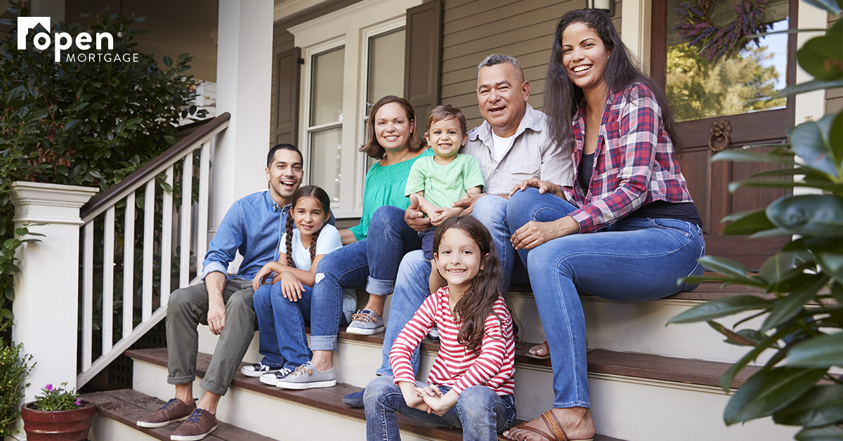 Family sitting on front steps of a house