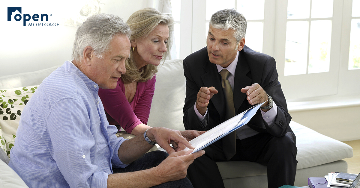 three people going over a document