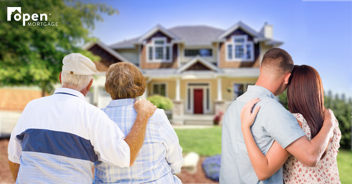 Two couples looking at a house