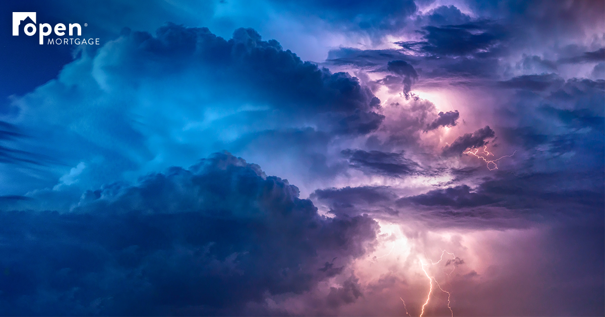 purple and blue storm clouds with lightning strike