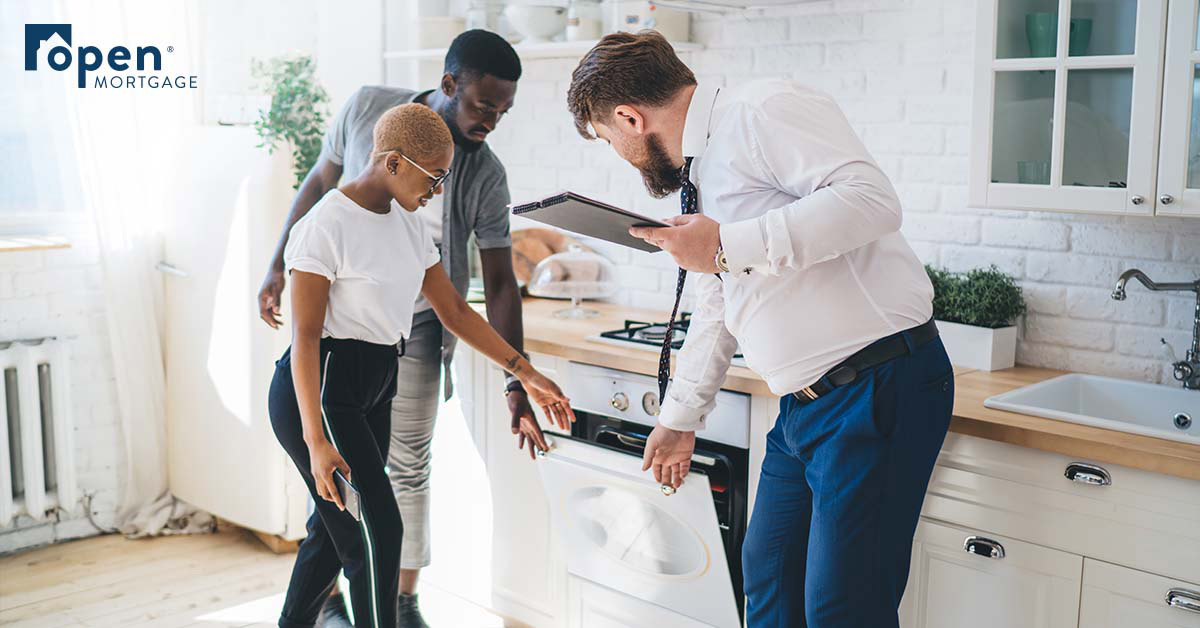 Realtor showing couple a dishwasher
